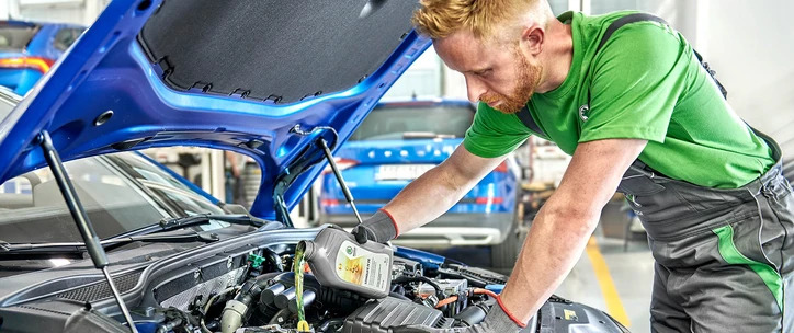 Two Services - Man refilling engine oil